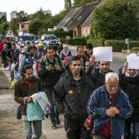 Middle Eastern migrants, who came from Germany by ferry and train Sunday night, and are walking  from Rodby in southern Denmark towards Sweden on Monday Sept. 7, 2015. Most of the migrants came from Syria, and  wished to continue to Sweden where they will seek asylum. The distance from Rodby to the Oresundsbron in  Sweden is 180 kilometres. (AP Photo/POLFOTO, Per Rasmussen)  DENMARK OUT