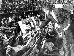 John F. Kennedy campaigns at Atwood Stadum before the 1960 presidential election. Kennedy returned in '62 to stump for Democratic gov. John B. Swainson, who lost to George W. Romney. Photo taken by Bill Gallagher on Sep 1960.