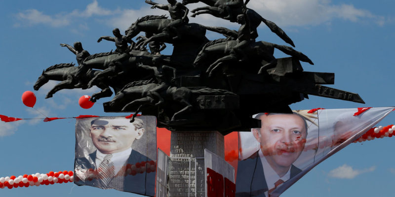 Posters of Turkey's founder Mustafa Kemal Ataturk and Turkish President Tayyip Erdogan are seen on a monument in Izmir