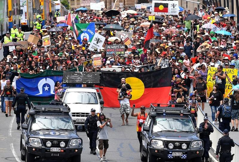 Police escort people joining a march with Aboriginal protesters on Australia Day in central Brisbane, Australia, January 26, 2017. AAP/Dan Peled/via REUTERS
