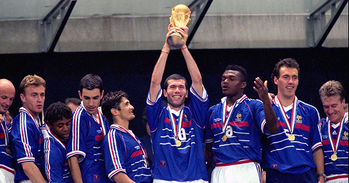 France's Zinedine Zidane holds aloft the World Cup flanked by his teammates